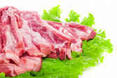 Raw pork ribs on lettuce — Stock Photo
