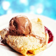 Forest fruits crepe served with a scoop of chocolate ice cream — Stock Photo #30139431
