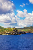 A small church on the rocky Aegean shore — Stock Photo