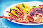 Grilled squid with a side salad, selective focus — Stock Photo
