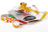 Tape-measure and medicament about kitchen scale — Stock Photo
