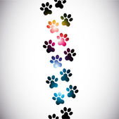 Abstract colorful paw prints — Stock Vector