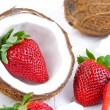 Strawberries and coconut — Stock Photo