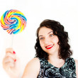 Retro woman with a lollipop — Stock Photo