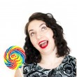 Retro woman with a lollipop — Stock Photo #26697303