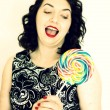 Retro woman with a lollipop — Stock Photo #41988335