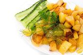Homemade food: salads and grilled potato — Stock Photo