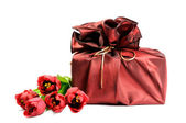 Gift with flowers — Stock Photo