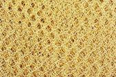 Pletené zlatý textura — Stock fotografie