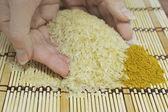 Handful of rice — Stock Photo