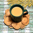 Cup of coffee with milk on a pine stand — Lizenzfreies Foto