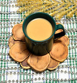 Cup of coffee with milk on a pine stand — Stock Photo