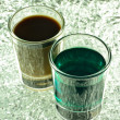 Shot Glass with Green and Coffee Cocktails — Stock Photo
