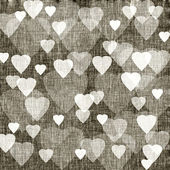 Brown background with hearts, linen texture — Stock Photo