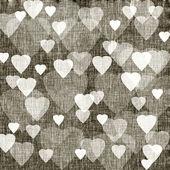 Brun bakgrund med hjärtan, linne konsistens — Stockfoto