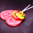 Heart shaped and round spiral lollipops — Stock Photo