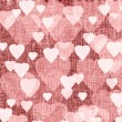 Bright red textured background with hearts, linen, fabric — Stock Photo