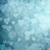 Blue textured background with hearts, linen, fabric — Stock Photo