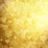 Golden background with hearts, festive texture — Stockfoto