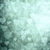 Metallic background, glowing texture with hearts — Stock Photo