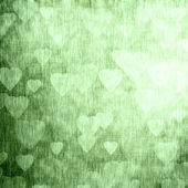 Green texture with hearts, festive background — Stock Photo