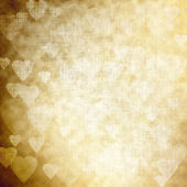Golden background with hearts, festive texture — Stock Photo