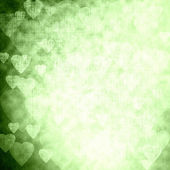 Green texture with hearts, festive background — 图库照片