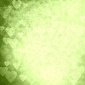 Green texture with hearts, festive background — Photo