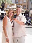 Romantic senior mature couple taking selfie photo on vacation — Stock Photo