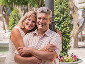 Romantic smiling mature healthy romantic middle-aged couple — Stock Photo