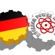 Germany national flag and atom energy symbol on gears — Stock Photo #47934751