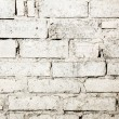 Wasted white brick wall background — Stockfoto