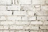 Verspilde witte bakstenen muur achtergrond — Stockfoto