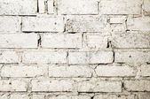 Wasted white brick wall background — Foto Stock