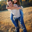 Stock Photo: Young couple playing in fall