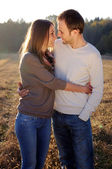 Young hugging couple in fall — Stock Photo