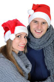 Smiling couple in Santa Claus Hat — Stock Photo