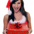 Sexy Santa Claus Girl with a gift — Stock Photo