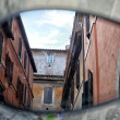 Italian architecture reflected in a mirror — Stock Photo