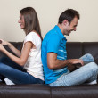 Stock Photo: Couple surfing the internet with laptop and tablet computer
