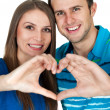 Young couple making heart gesture of love  — Stock Photo