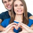 Stock Photo: Couple making heart gesture of love