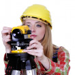 Stock Photo: Land surveyor working with theodolite