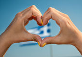 I love Greece heart gesture with Greek flag in the backgroud — Stock Photo