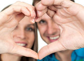Close-up of Couple making heart gesture of love — Stock Photo
