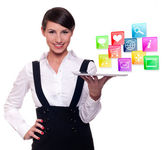 Young businesswoman with tablet computer and mobile and internet technology icons — Stock Photo