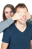 Young woman covering her man's eyes to surprise him — Stock Photo
