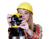 Land surveyor working with theodolite — Stock Photo