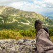 Hiking boots of a hiker while taking a rest in the mountains — Stock Photo