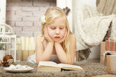 Child girl reading a book — Stock Photo